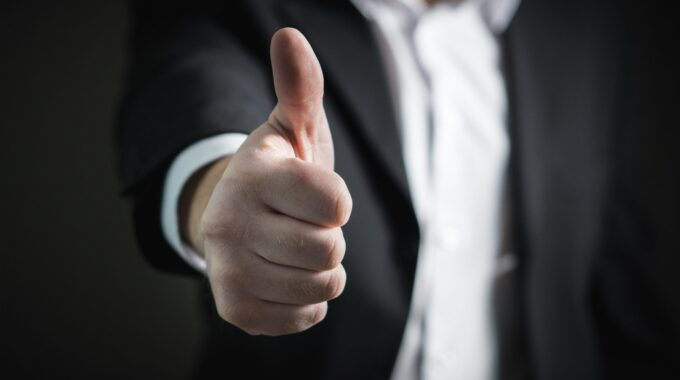 Image Of Person Giving A Thumbs Up, Close Up On The Thumb